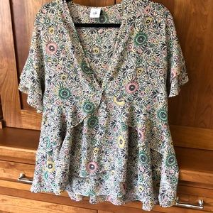 Floral blouse with fun feminine details